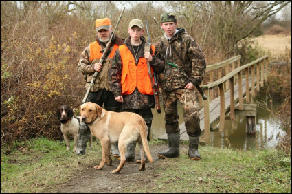 father-sons-dog-hunting